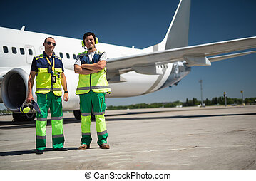 Cheerful workers at airport