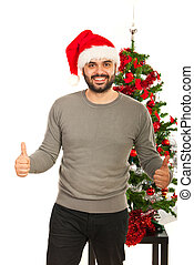Cheerful Xmas man giving thumbs up