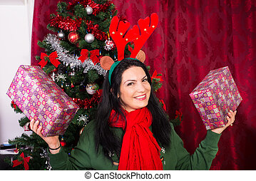 Cheerful Xmas woman showing gifts