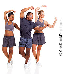young adults working out - cheerful young adults working out...
