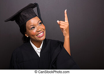 young african american graduate pointing up