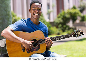 young african american man playing guitar