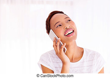 young african american woman talking on smart phone
