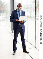 young african businessman using laptop