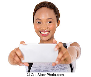 young african college girl taking self portrait - cheerful ...