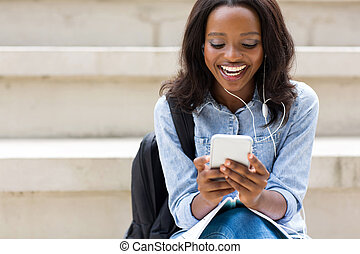 young african college girl using smart phone