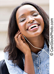 young african college student listening to music