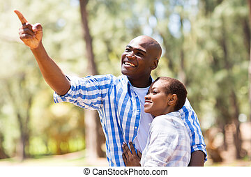 young african couple in the forest
