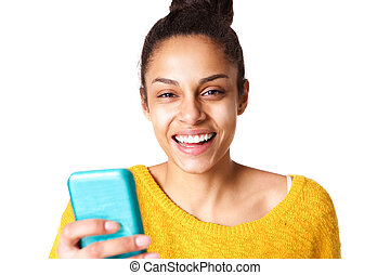 Cheerful young african woman with a mobile phone