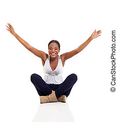 young afro american woman sitting on floor