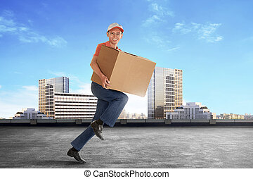 Cheerful young asian courier holding a cardboard box