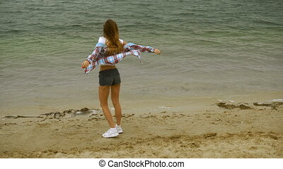 cheerful young blonde on a seashore
