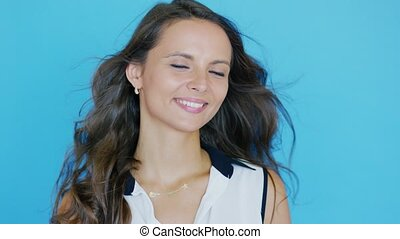Cheerful young brunette with waving hair - Attractive young...