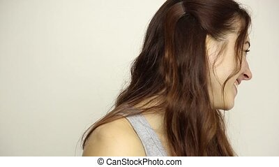 Cheerful young brunette woman smiling and laughing