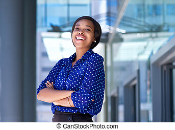 Cheerful young business woman laughing