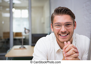 Cheerful young businessman at office - Close up portrait of...