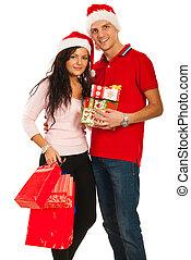 Cheerful young Christmas couple