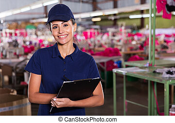 clothing factory supervisor standing in production area -...
