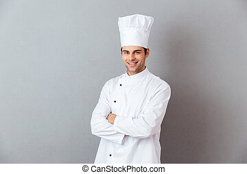 Cheerful young cook in uniform