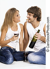Cheerful young couple drinking wine