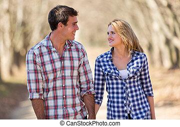 young couple enjoying a walk in fall