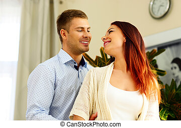 Cheerful young couple looking at each other