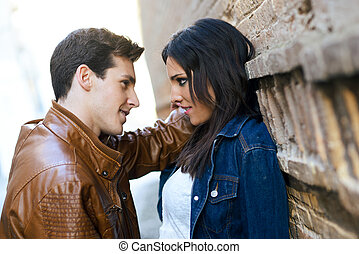 Cheerful young couple on a city street