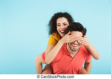 Cheerful young couple standing isolated
