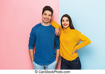 Cheerful young couple standing
