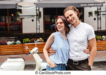 Cheerful young couple standing together