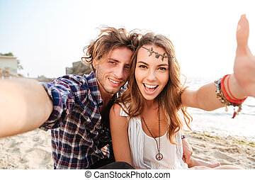 Cheerful young couple taking selfie