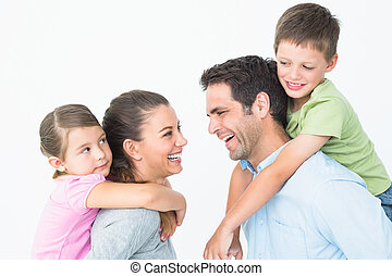 Cheerful young family posing