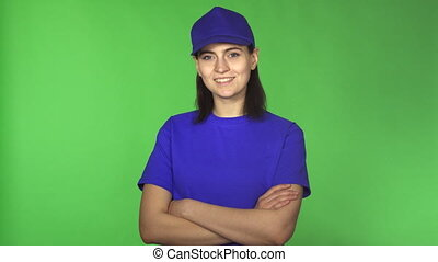 Cheerful young female delivery worker smiling to the camera