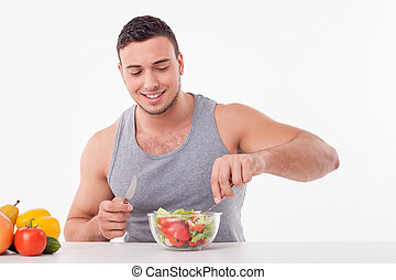 Cheerful young fit guy is very hungry
