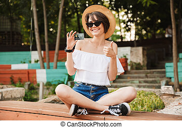 Cheerful young girl dressed in summer clothes