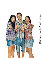 Cheerful young group of people pointing to  you