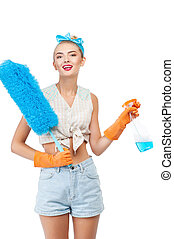 Cheerful young healthy woman is doing housework