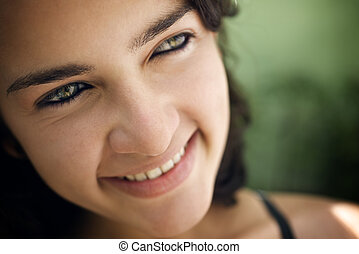 Cheerful young hispanic woman looking at camera and smiling