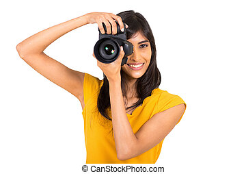 young indian woman taking pictures - cheerful young indian ...