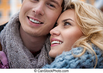 Cheerful young man and woman bonding to each other