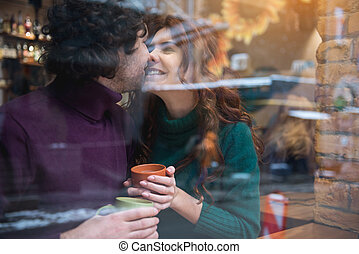 Cheerful young man and woman expressing their love