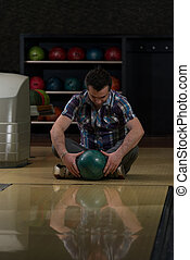 Cheerful Young Man Holding Bowling Ball