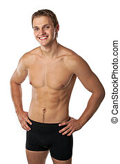 Cheerful young man in trunks over white