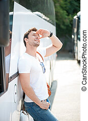 Cheerful young man is using public transport