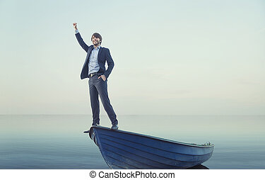 Cheerful young man on the tiny boat