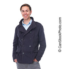 Cheerful young man smiling in blue jacket