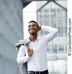Cheerful young man smiling with white shirt