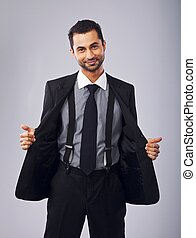Cheerful Young Professional Holding Open His Coat - Portrait...
