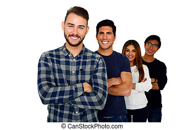 Cheerful young students standing in a row over white background