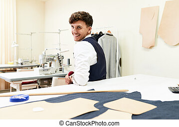 Cheerful Young Tailor in Workshop